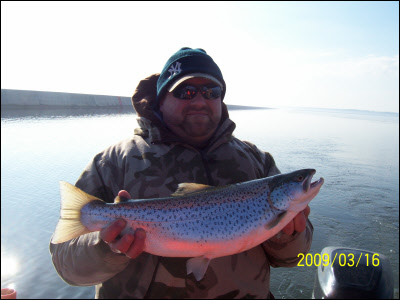 man holding a milwaukee brown trout